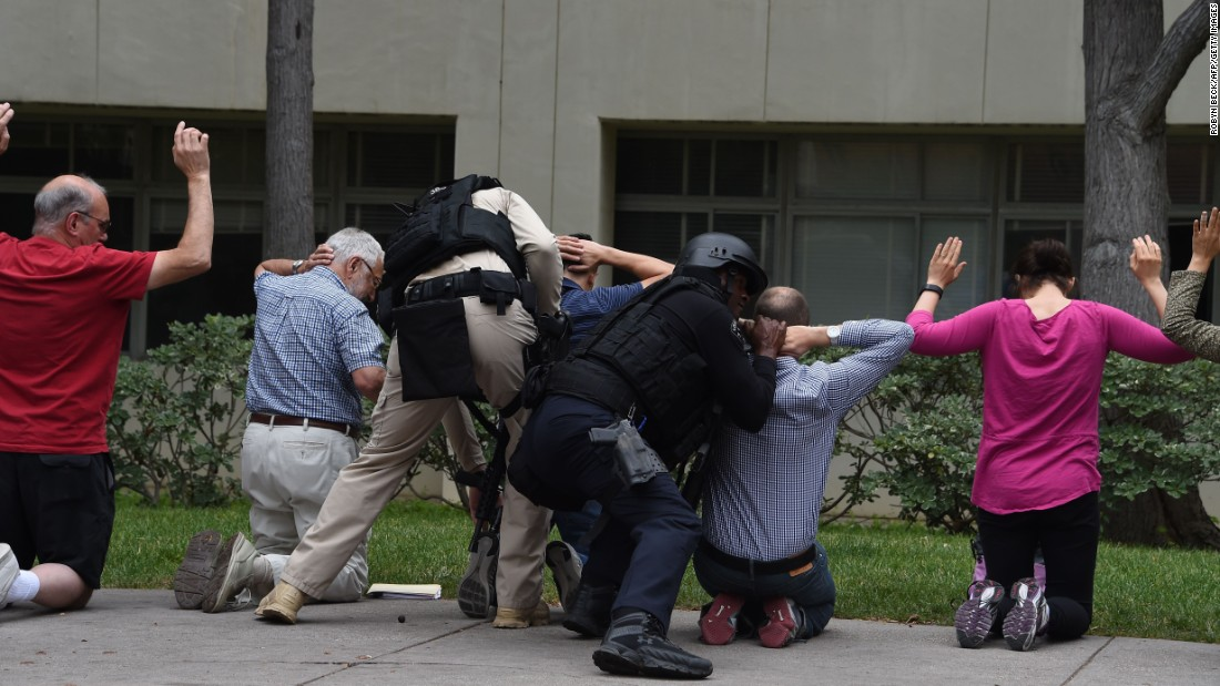 "Security personnel check people on the UCLA campus following a shooting at the university on Wednesday, June 1. A campus-wide lockdown was in effect for a short time, but Los Angeles' police chief later said the situation was under control and that <a href=""http://www.cnn.com/2016/06/02/us/ucla-shooting/index.html"" target=""_blank"">the shooting was a murder-suicide. </a>"