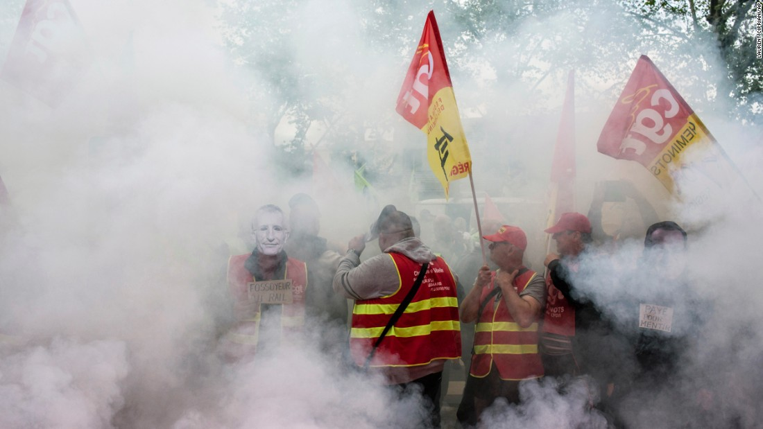 "French rail workers protest in front of a union branch in Lyon, France, on Wednesday, June 1. They have gone on strike, <a href=""http://www.cnn.com/2016/06/02/europe/france-strikes-labor-reform-bill/"" target=""_blank"">joining workers from other industries</a> who are unhappy with their working conditions and government labor reforms."