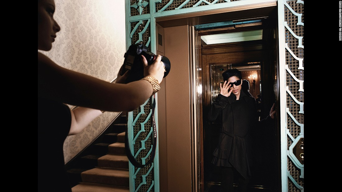 The photo essay in the book told the story of Prince taking a residency at London's Dorchester Hotel. The pictures were shot by famed photographer Randee St. Nicholas.