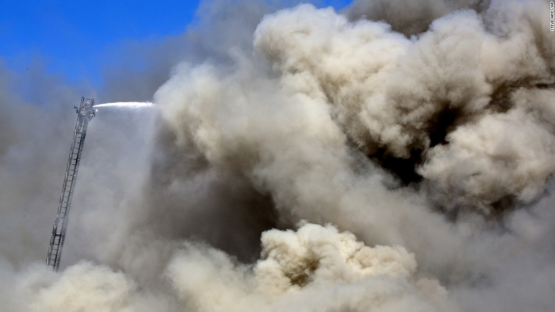 Firefighters in Madison, Wisconsin, respond to an explosion at a recycling plant's scrap metal heap on Wednesday, June 1.