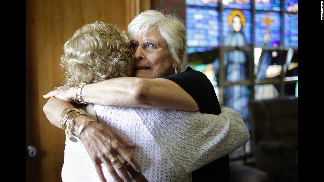 "Nancy Shilts, right, hugs a fellow parishioner in Scituate, Massachusetts, before a planned final service at St. Frances X. Cabrini Church on Sunday, May 29. For more than 11 years, a core group of about 100 parishioners <a href=""https://www.bostonglobe.com/metro/2016/05/29/parishioners-say-farewell-scituate-church-after-nearly-year-vigil/PT777HHaMYBYwXZ1Qbb3gM/story.html"" target=""_blank"">had kept the parish open</a> by maintaining a round-the-clock vigil. The Boston Archdiocese has wanted to close it since 2004."