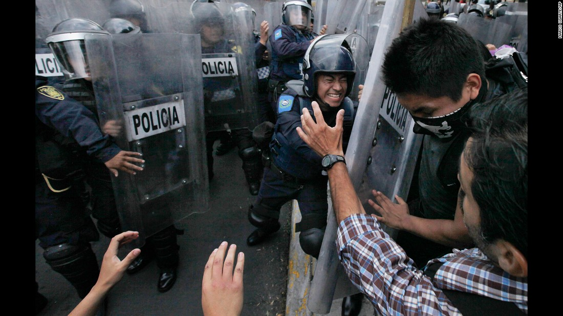 Animal rights activists clash with riot police outside a bullfighting ring in Mexico City on Sunday, May 29.