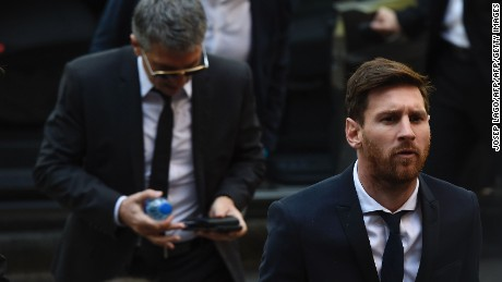 Barcelona's football star Lionel Messi (R) followed by his father Jorge Horacio Messi arrives at the courhouse on June 2, 2016 in Barcelona, where Messi and his father are to face judges in a tax fraud case. The 28-year-old football star was cheered and jeered as he emerged from a van accompanied by his father Jorge Horacio Messi. The two are accused of using a chain of fake companies in Belize and Uruguay to avoid paying taxes on 4.16 million euros ($4.6 million) of Messi's income earned through the sale of his image rights from 2007-09. / AFP / JOSEP LAGO        (Photo credit should read JOSEP LAGO/AFP/Getty Images)