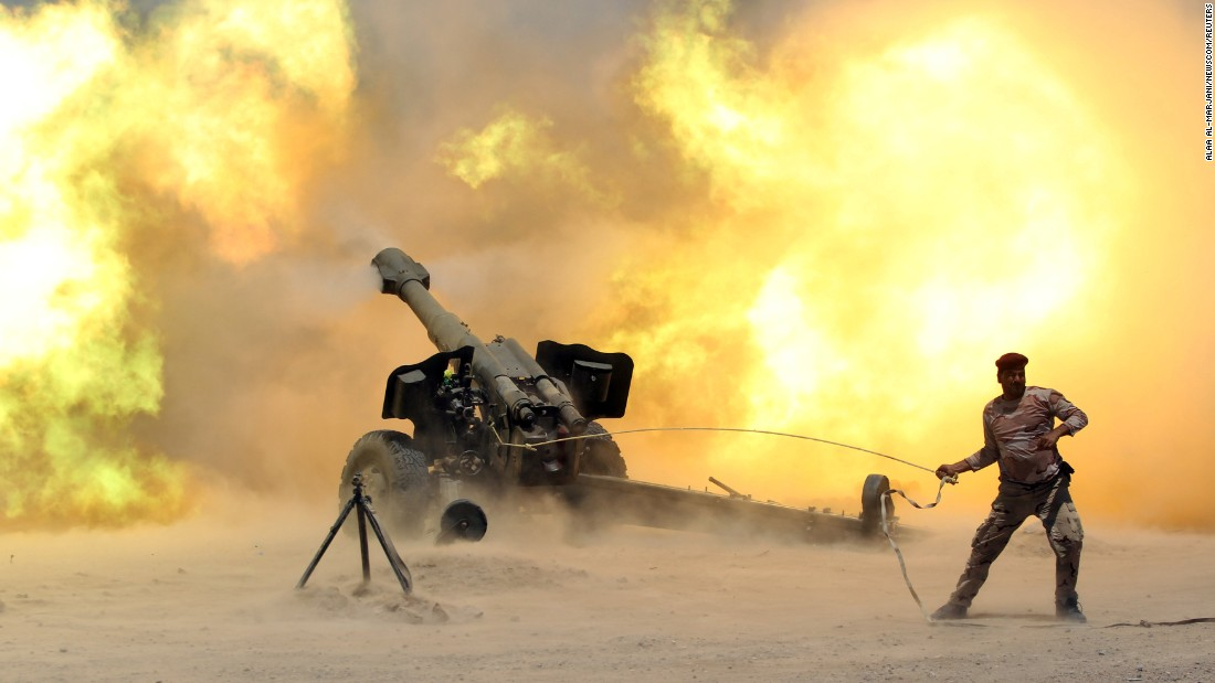 "A member of Iraq's security forces fires artillery Sunday, May 29, during clashes with ISIS militants near Falluja, Iraq. <a href=""http://www.cnn.com/2016/05/26/middleeast/gallery/battle-for-falluja/index.html"" target=""_blank"">Falluja</a> remains one of the last two Iraqi cities under ISIS control."