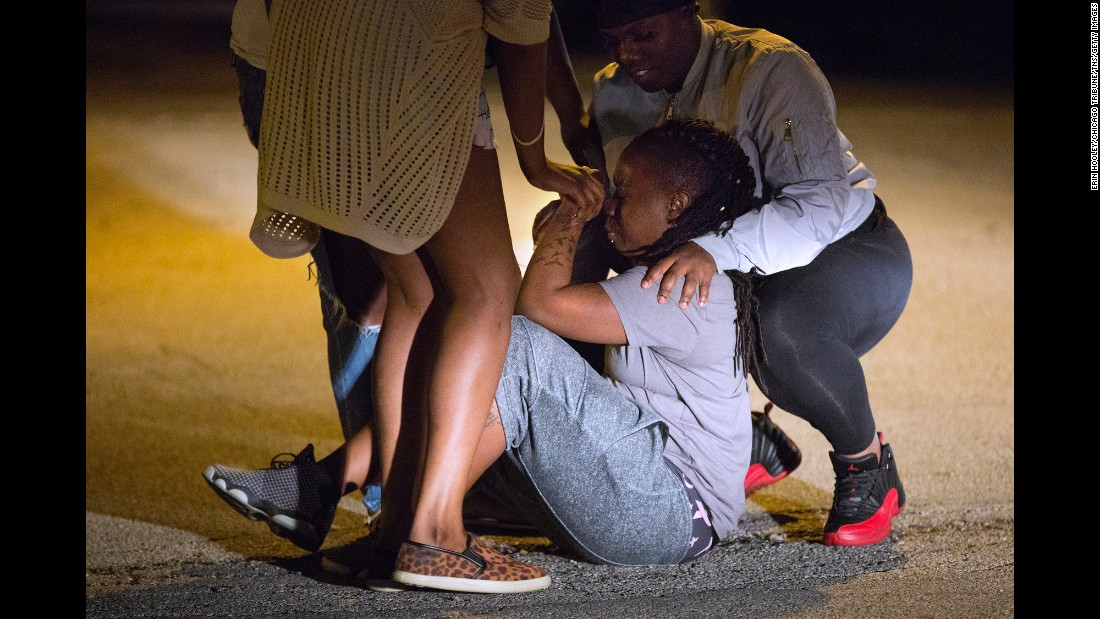 "A woman is comforted outside of a Chicago hospital on Wednesday, June 1. A 15-year-old boy, identified by the <a href=""http://www.chicagotribune.com/news/local/breaking/ct-chicago-violence-shootings-20160531-story.html"" target=""_blank"">Chicago Tribune</a> as Fabian Lavinder, died at the hospital after he was fatally shot in the vehicle he was sitting in."