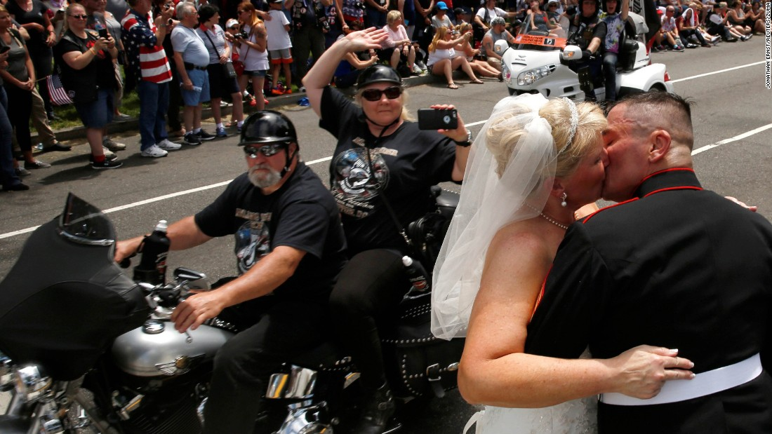 "Retired Marine Staff Sgt. Tim Chambers and his new wife, Lorraine, kiss during Rolling Thunder's annual ""Ride for Freedom"" parade in Washington on Sunday, May 29. The biker rally is a tradition on Memorial Day weekend, paying tribute to prisoners of war and Americans missing in action."