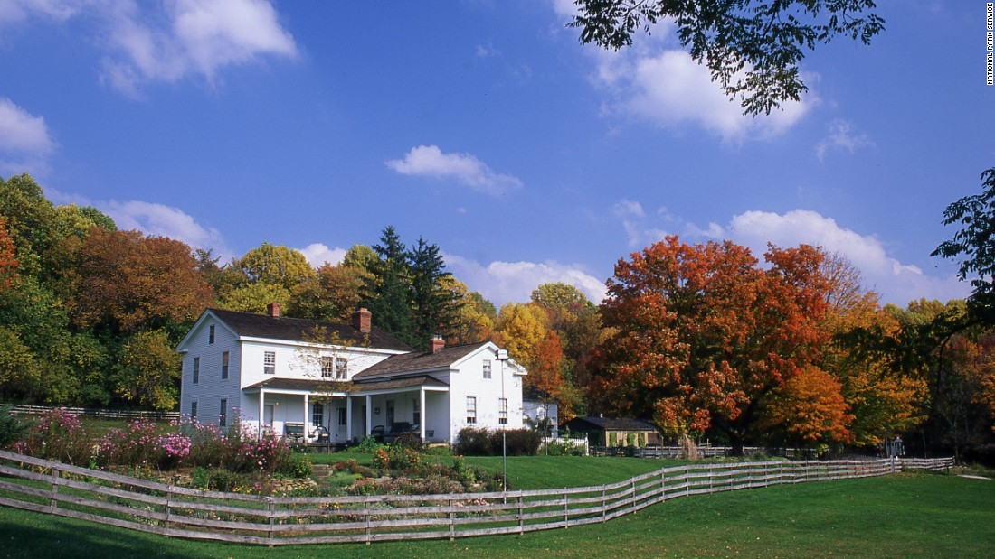 Built in 1848 as the home of James and Adeline Wallace, the Inn at Brandywine Falls is now within Cuyahoga Valley National Park in Ohio. The six-room inn overlooks the 65-foot Brandywine Falls.