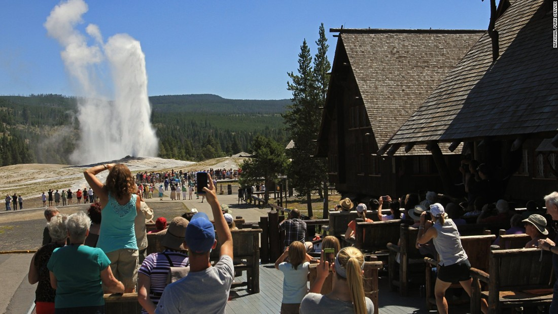 Built in 1904 with local logs and stone, Old Faithful Inn is near Old Faithful Geyser in Yellowstone National Park in Wyoming.