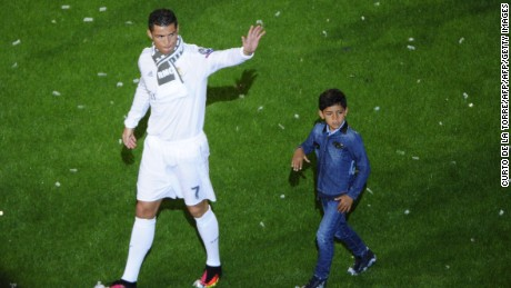 Ronaldo celebrates winning the Champions League with his son, Cristiano Jr.