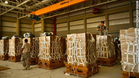 The U.S. Army prepares packages of meals for a 2014 airdrop in southwest Asia.