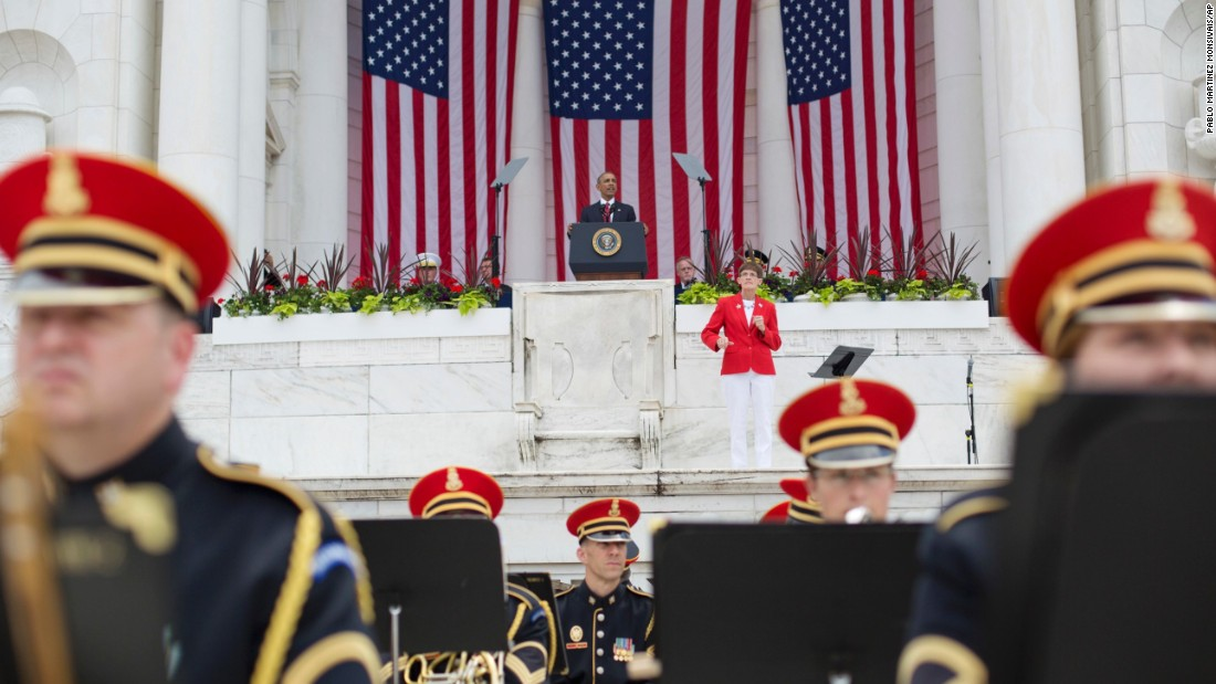 "U.S. President Barack Obama <a href=""http://www.cnn.com/2016/05/30/politics/obama-memorial-day-arlington-cemetery/"" target=""_blank"">pays tribute to fallen soldiers</a> during a Memorial Day ceremony at Arlington National Cemetery. ""Whether they stood up in times of war, signed up in times of peace or were called up by a draft board,"" Obama said, ""they embodied the best of America."""