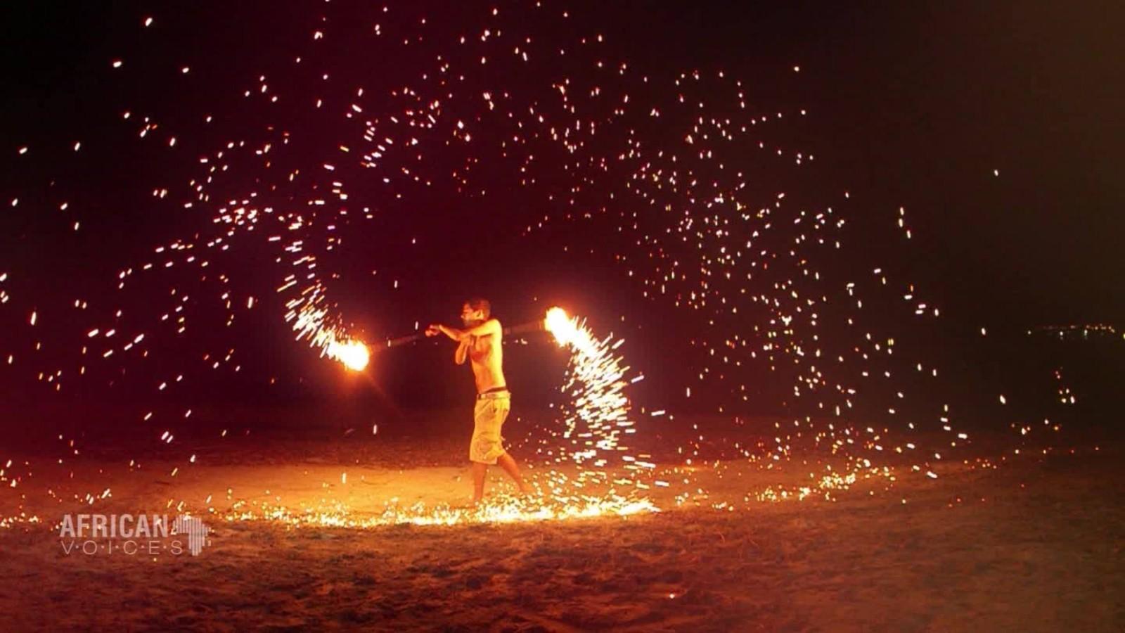 fire twirling in video