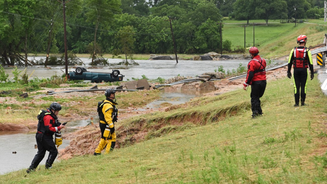 "Rescue crews search for a missing man near Brenham, Texas, on Friday, May 27. The man's truck, seen in the background, was found flipped over along Rocky Creek. At least seven people <a href=""http://www.cnn.com/2016/05/29/us/flooding-texas-kansas/"" target=""_blank"">died in flood-related incidents</a> after the region was inundated with rain, authorities said."
