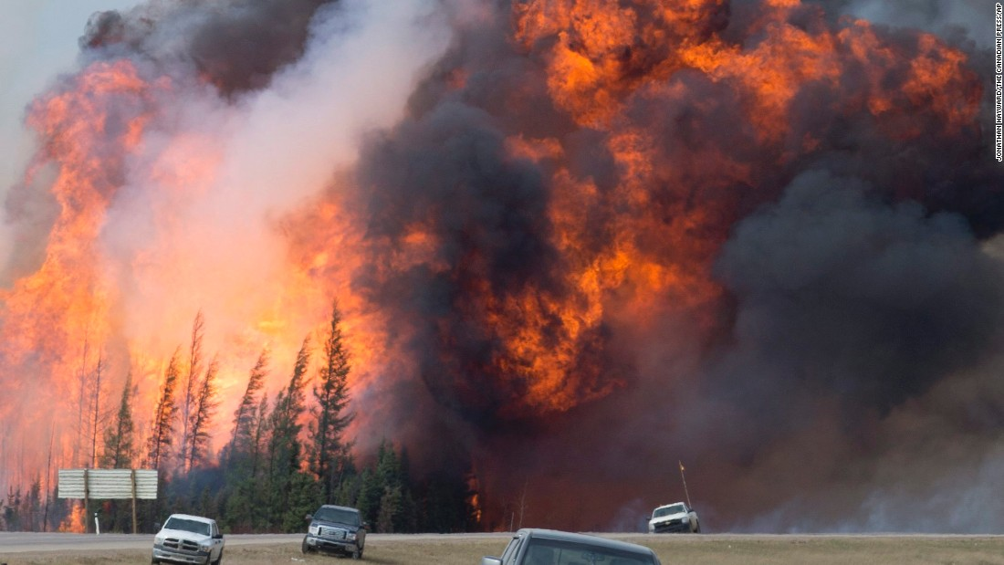 "A wildfire rips through the forest near Fort McMurray, Alberta, on Saturday, May 7. More than 88,000 people <a href=""http://www.cnn.com/2016/05/05/world/gallery/canada-wildfire-fort-mcmurray/index.html"" target=""_blank"">were forced to flee their homes.</a>"