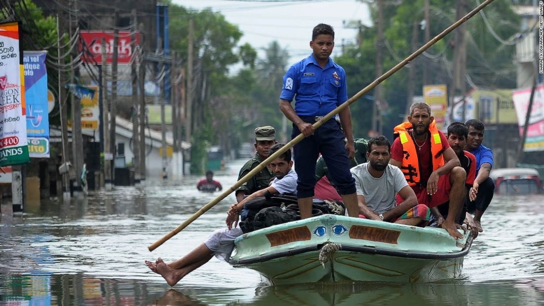 "Sri Lankan military personnel evacuate homes following flooding in the Kolonnawa suburb of Colombo on Friday, May 20. <a href=""http://www.cnn.com/2016/05/22/asia/sri-lanka-flooding-deaths/index.html"" target=""_blank"">At least 100 people died and thousands were displaced by flooding in the country.</a>"