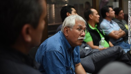Guatemala's former Minister of Agriculture Cattle and Feeding (2000-2004) Edin Barrientos sits along with a group of suspects, during the court hearing in Guatemala City on June 2, 2016.  At least 23 people were arrested on suspicion of links with money laundering from corruption in the government and political parties illicit financing. the Prosecutor's office informed. / AFP / JOHAN ORDONEZ        (Photo credit should read JOHAN ORDONEZ/AFP/Getty Images)