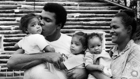 Ali stands with his wife and children outside his training camp in Deer Lake, Pennsylvania.