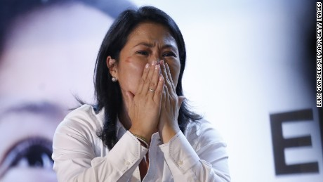 Keiko Fujimori of the Fuerza Popular party reacts during a brief appearance in front of supporters at her party's headquarters in a local hotel as news arrives that the polls have turned against her, in favor of her rival Pedro Pablo Kuzcynski of Peruanos por el Kambio, hours after the closing of the voting stations in the runoff elections on June 5, 2016. Peruvians voted Sunday in a close-fought runoff election that will decide whether Kuczynski or Fujimori, the daughter of former president Alberto Fujimori, in jail for corruption and crimes against humanity, will be their new leader. / AFP / LUKA GONZALES        (Photo credit should read LUKA GONZALES/AFP/Getty Images)