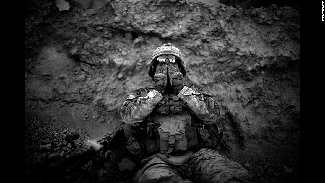 "U.S. Marine Lance Cpl. Anthony Espinoza wipes the salt and sweat out of his eyes at the end of a daylong patrol in Afghanistan in May 2011. Gilkey ""was profoundly committed to coverage of both Afghanistan and Iraq,"" NPR head of news Michael Oreskes said. ""He wanted to know what was happening to the people there. I think that's why he kept going back -- because he wanted to understand what was happening to the soldiers and civilians."""