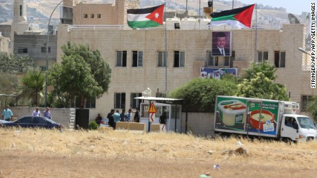 Security personnel are outside a Jordanian intelligence agency office in the Baqaa refugee camp following Monday's attack.