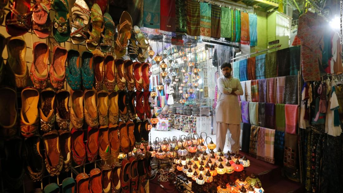 A vendor stands outside a shop in Dubai, United Arab Emirates, on June 5.