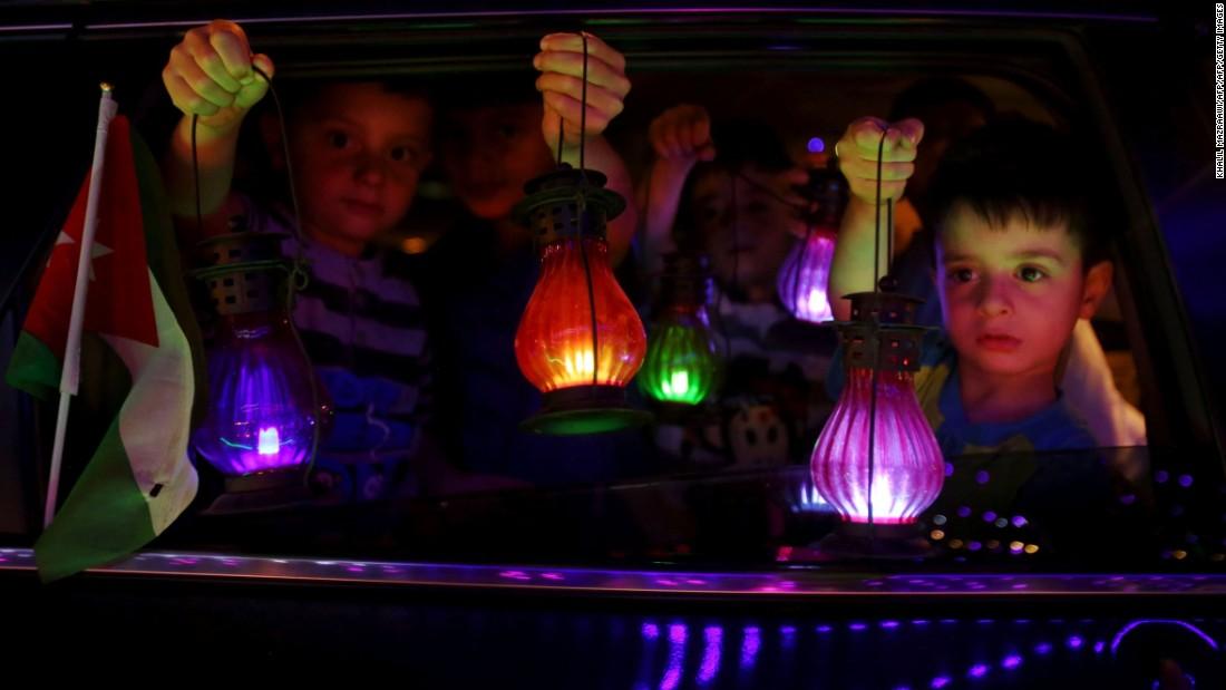 Children in Amman, Jordan, hold traditional lanterns at the start of Ramadan on Sunday, June 5.
