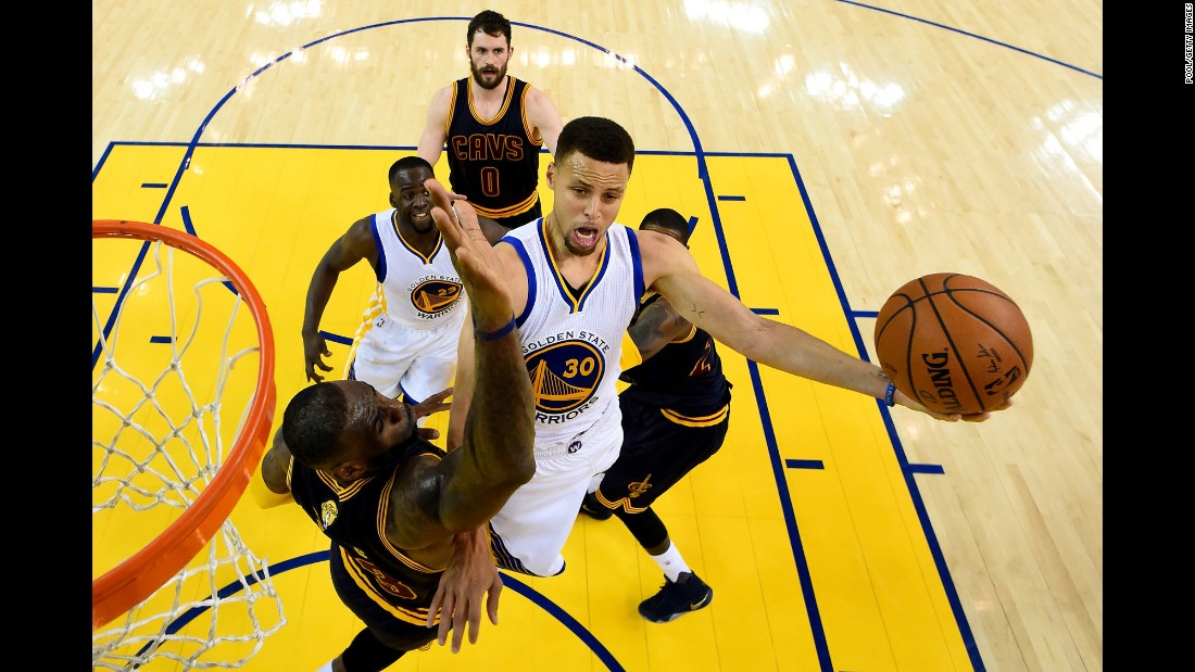 Golden State's Stephen Curry goes up for a shot over Cleveland's LeBron James during Game 2 of the NBA Finals on Sunday, June 5. Golden State, the league's defending champions, won the first two games of the best-of-seven series.