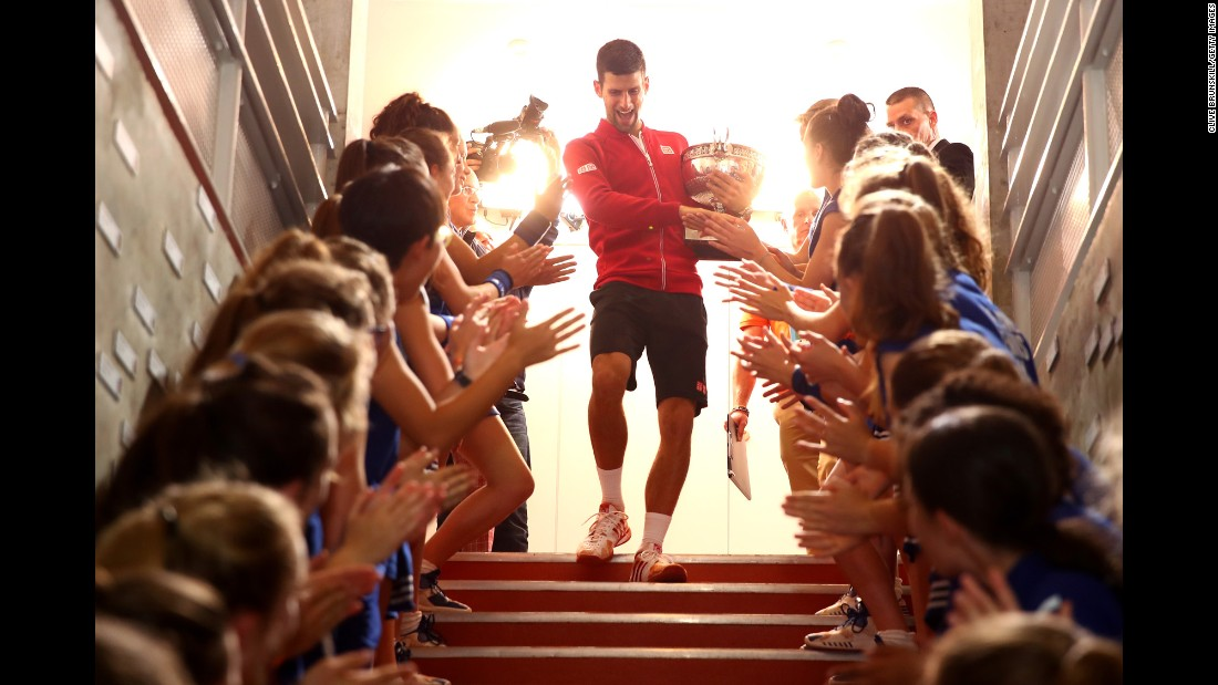 "Novak Djokovic celebrates <a href=""http://www.cnn.com/2016/06/06/tennis/novak-djokovic-french-open-roland-garros-history/index.html"" target=""_blank"">his French Open title</a> with the tournament's ball girls on Sunday, June 5. By defeating Andy Murray, Djokovic completed the career Grand Slam. He is also the first man since Rod Laver in 1969 to hold all four Grand Slam titles at once."