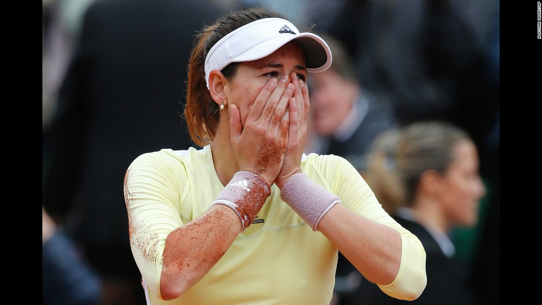 "Garbine Muguruza reacts after winning the French Open on Saturday, June 4. The Spaniard <a href=""http://www.cnn.com/2016/06/04/tennis/french-open-serena-williams-muguruza-tennis/index.html"" target=""_blank"">defeated Serena Williams</a> for her first-ever Grand Slam title."