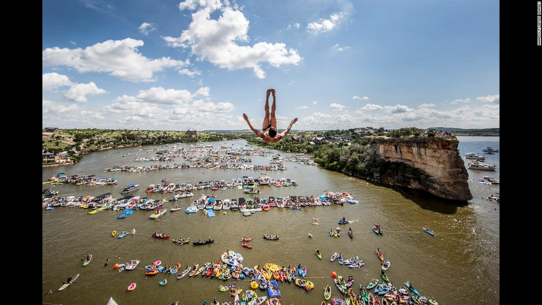 Jonathan Paredes dives into Texas' Possum Kingdom Lake on Saturday, June 4. Paredes finished first in what was the opening event of the Red Bull Cliff Diving World Series.