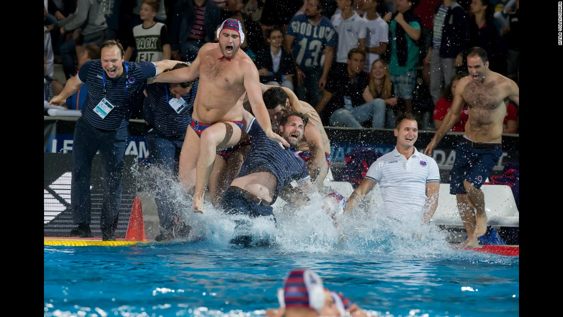 Members of VK Jug, a water polo team from Dubrovnik, Croatia, celebrate after winning the Champions League title in Budapest, Hungary, on Saturday, June 4.