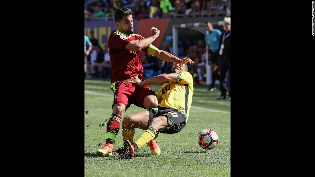 Venezuela's Tomas Rincon, left, collides with Jamaica's Jobi McAnuff during a Copa America match in Chicago on Sunday, June 5. Venezuela won the match 1-0.