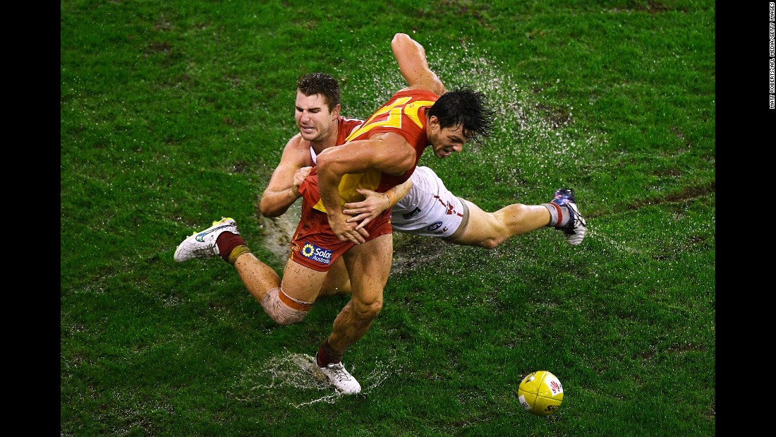 Harrison Marsh of the Sydney Swans tackles Jesse Lonergan of the Gold Coast Suns during an Australian Football League match on Saturday, June 4.