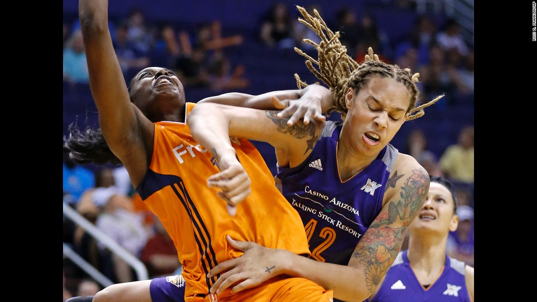 Connecticut's Chiney Ogwumike, left, is fouled by Phoenix's Brittney Griner during a WNBA game in Phoenix on Tuesday, May 31.
