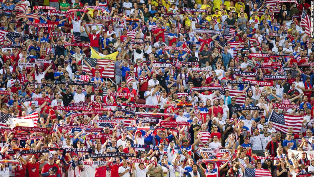 Fans of the U.S. men's soccer team hold scarves and flags before the opening game of the Copa America tournament on Friday, June 3. The Americans lost 2-0 to Colombia in Santa Clara, California.