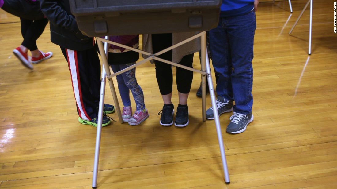 Children accompany their mother as she casts a vote in Stamford, Connecticut, on Tuesday, April 26.