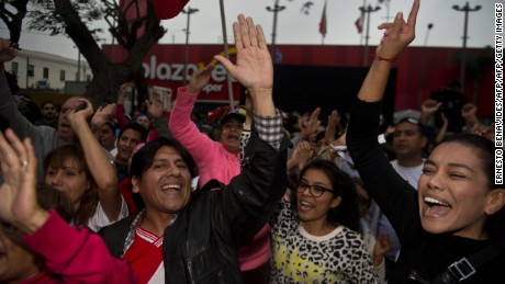 "Supporters of Peruvian presidential candidate Pedro Pablo Kuczynski celebrate the preliminary results, pointing to a photo finish, at the ""Peruanos por el Kambio"" party headquarters in Lima on June 5, 2016.  Peruvians voted Sunday in a close-fought runoff election that will decide whether Kuczynski or Keiko Fujimori, the daughter of former president Alberto Fujimori, in jail for corruption and crimes against humanity, will be their new leader. / AFP / ERNESTO BENAVIDES        (Photo credit should read ERNESTO BENAVIDES/AFP/Getty Images)"