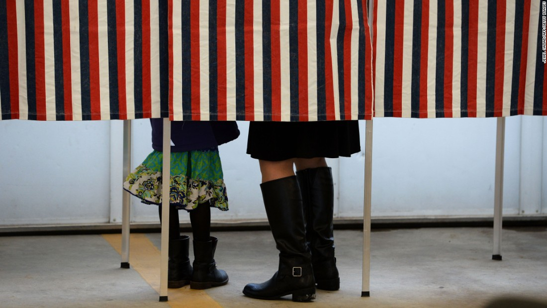 A woman is accompanied by a child as she votes in Loudon, New Hampshire, on Tuesday, February 9.