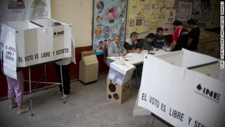 Citizens vote in the election of governors on June 5, 2016 in Mexico City.  Mexicans went to the polls on Sunday to elect governors of 12 states, elections in which the ruling party (Institutional Revolutionary Party,  PRI) will try to maintain its historic control in two regions affected by drug violence. / AFP / YURI CORTEZ        (Photo credit should read YURI CORTEZ/AFP/Getty Images)