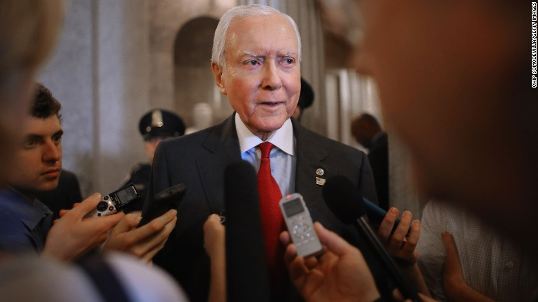WASHINGTON, DC - MAY 18: Sen. Orrin Hatch (R-UT) (C) talks with reporters after leaving the Senate floor at the U.S. Capitol May 18, 2015 in Washington, DC. Senate Majority Leader Mitch McConnell (R-KY) said that he will postpone the Senate's Memorial Day recess until lawmakers tackle a trade bill, renewal of the Patriot Act and funding for federal highways. (Photo by Chip Somodevilla/Getty Images)