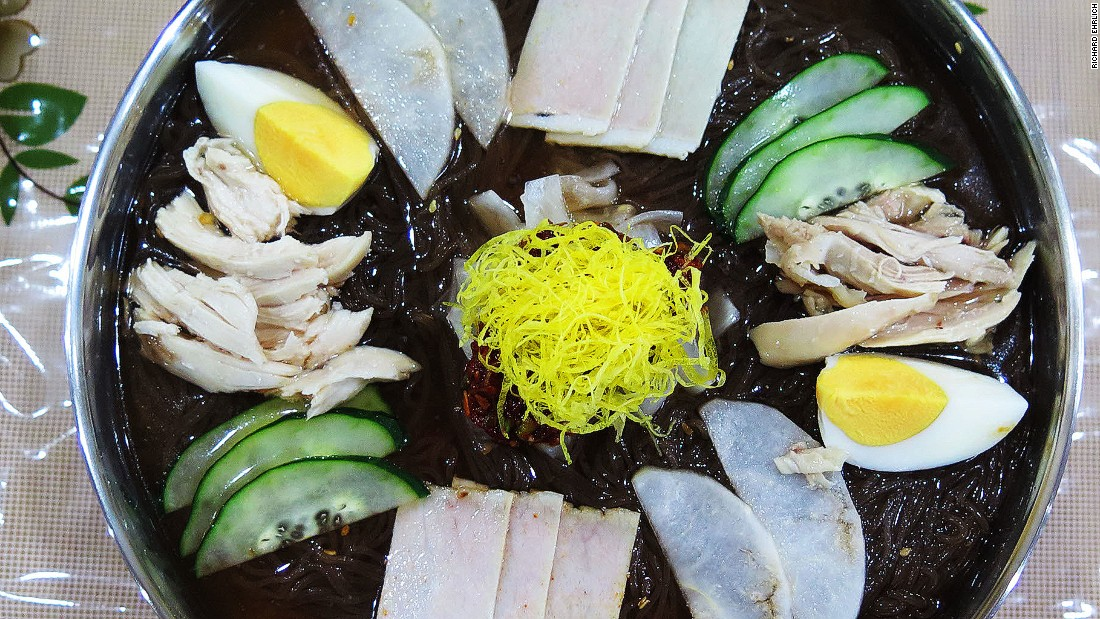 Large enough for two people,  Pyongyang Okryu's cold noodle tray includes slices of chicken, cucumber and a hard-boiled egg, plus red chilies, vinegar and mustard -- all draping spaghetti-like rice noodles, which a waitress will cut with big pink scissors.