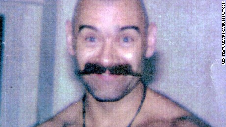 File photograph of Salvador, sporting his most famous look, the shaved head and moustache.
