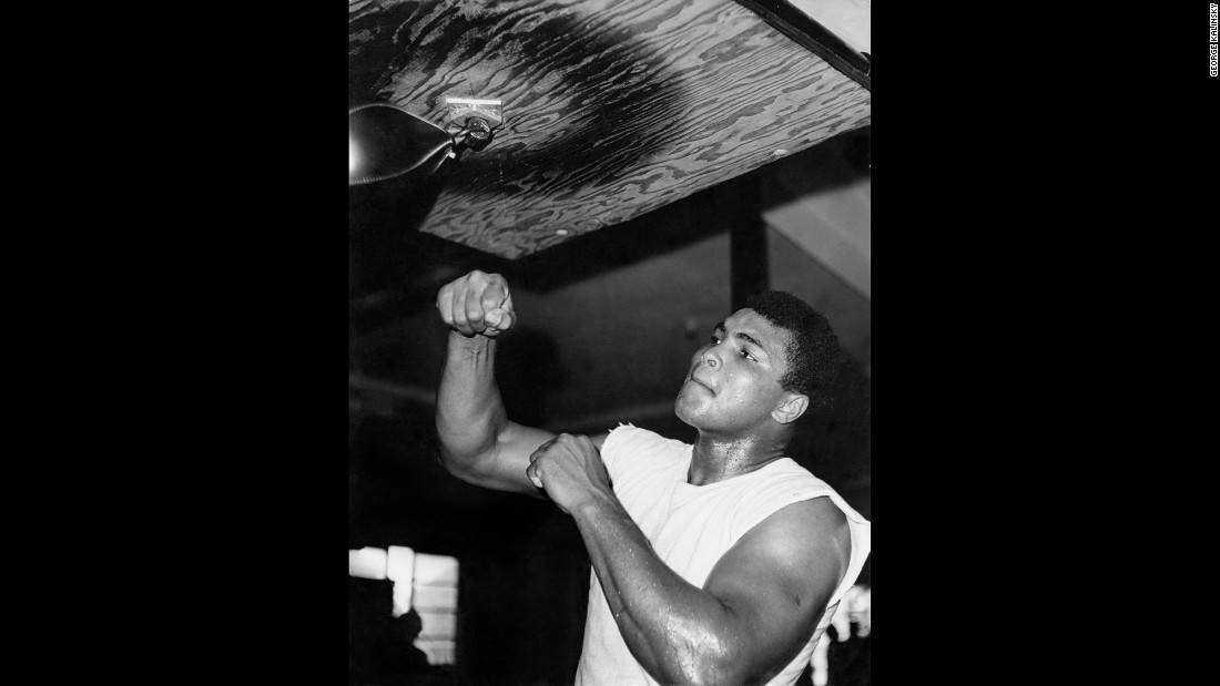 "Muhammad Ali trains at the 5th Street Gym in Miami in December 1965. The photo was taken by <a href=""http://www.georgekalinsky.com"" target=""_blank"">George Kalinsky,</a> an amateur who noticed Ali on the street and then talked his way into the gym. ""Ali's trainer, Angelo Dundee, stopped me and said you can't come in unless you pay a dollar,"" Kalinsky remembers. ""I don't know why, but I said to Angelo, 'I'm the photographer of Madison Square Garden.' ... He looked at me and said, 'OK, comedian, come on in.' "" Ironically, the Ali photos helped Kalinsky land an actual job at MSG a month later, so it wouldn't be the first time that he and the champ would cross paths."