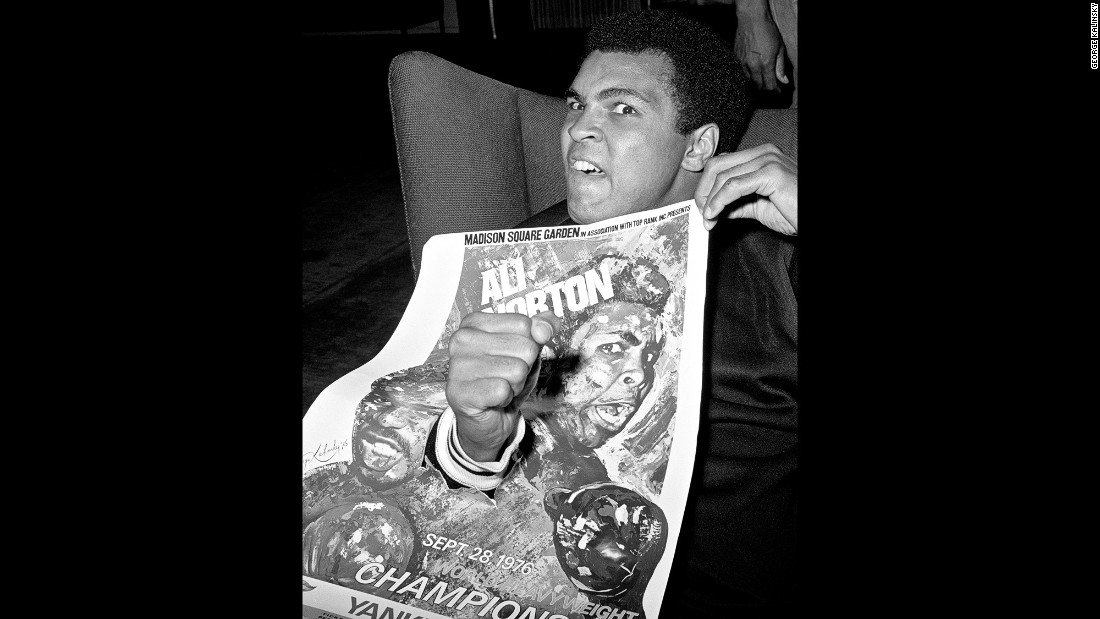 "Ali poses with a poster for his 1976 fight against Norton. ""The bottom line is that (Ali) was a great performer and he was a great athlete and he was a great entertainer,"" Kalinsky said. ""And he was very playful. He always liked to do playful things, things that are a little different, things that would bring smiles to people's faces."""