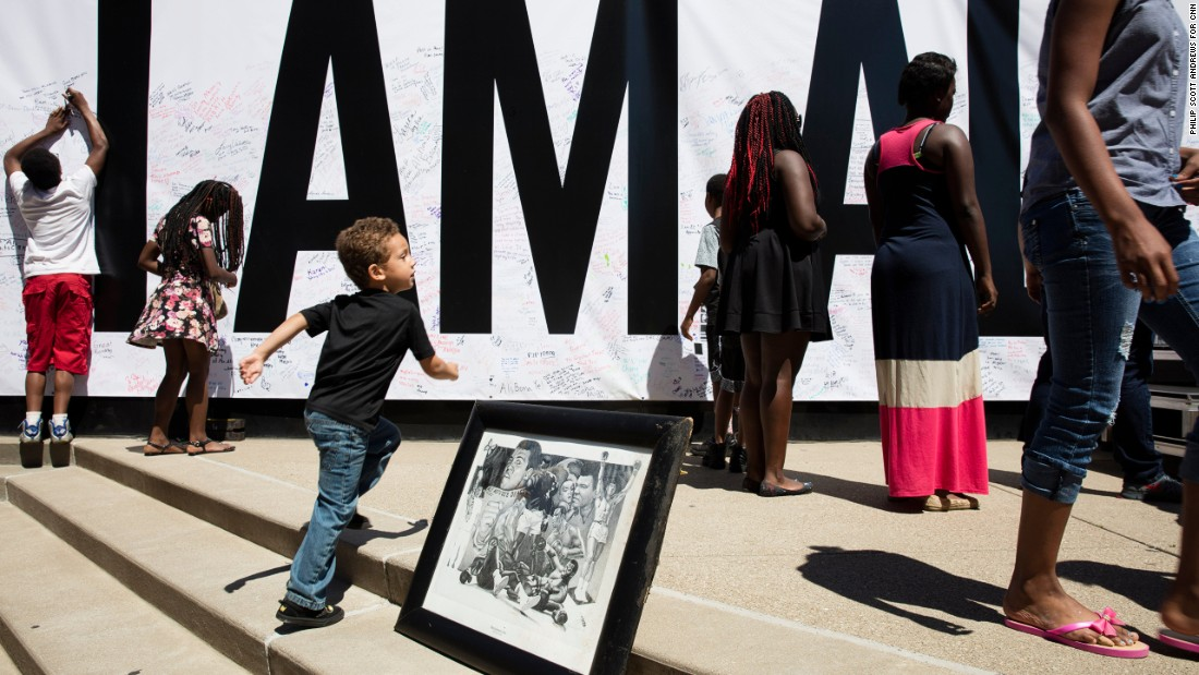 "<strong>June 8: </strong>A poster that says ""I Am Ali"" covers a wall at the Kentucky Center for the Arts in Louisville, Kentucky. <a href=""http://www.cnn.com/2016/06/08/us/muhammad-ali-celebration/"" target=""_blank"">A festival</a> was held there for <a href=""http://www.cnn.com/2016/06/03/sport/gallery/muhammad-ali/index.html"" target=""_blank"">boxing legend Muhammad Ali,</a> a Louisville native who died June 3 at the age of 74. <a href=""http://www.cnn.com/2016/06/09/sport/gallery/tbt-muhammad-ali/index.html"" target=""_blank"">Behind the scenes with Muhammad Ali</a>"