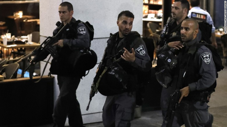 Tel Aviv suspect found hiding in home of off-duty cop