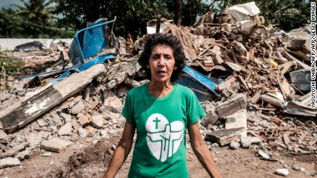 Maria da Penha amid the rubble of Rio de Janeiro's Vila Autodromo neighborhood near the city's Olympic Park.