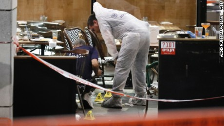 Israeli forensic police inspect a restaurant following a shooting attack at a shopping complex in the Mediterranean coastal city of Tel Aviv on June 8, 2016.  Two Palestinians opened fire at a popular Tel Aviv nightspot near Israel's military headquarters on June 8, 2016, police said, killing four people and injuring five in one of the worst attacks in a months-long wave of violence.  / AFP / JACK GUEZ        (Photo credit should read JACK GUEZ/AFP/Getty Images)