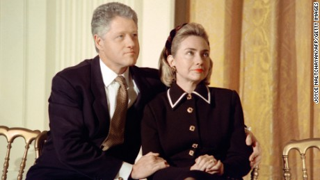 President Bill Clinton and his wife Hillary listen to speakers at a coalition for America's Children event at the White House in 1997.