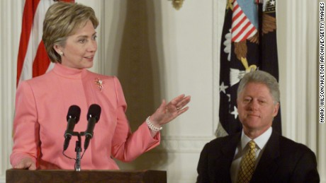 With President Clinton behind her First Lady Hillary makes remarks in the East Room of the White House in 2000.